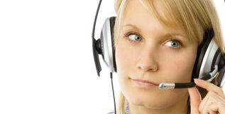 Woman operator. Portrait of attractive business woman with headset isolated over white background Royalty Free Stock Images