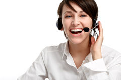 Woman operator with headset. Joyful woman operator with headset - microphone and headphones, on white Royalty Free Stock Photography