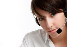 Woman operator with headset. Close-up of a woman helpline operator with headset - microphone and headphones, on white Royalty Free Stock Photography