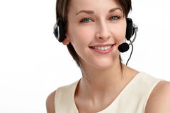 Woman operator with headset. Smiling woman operator with headset - microphone and headphones, on white Stock Photo