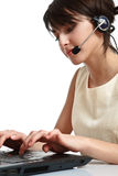 Woman operator with headset. (microphone and headphones) working - using a notebook royalty free stock images