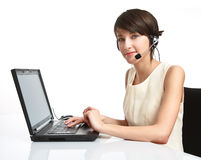 Woman operator with headset. (microphone and headphones) working - using a notebook stock images