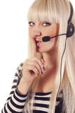 Woman operator with headset saying shh Royalty Free Stock Photo
