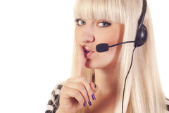 Woman operator with headset saying shh Stock Photography