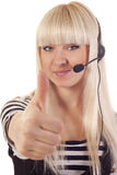 Woman operator with headset showing ok si Royalty Free Stock Image