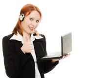 Woman operator helpline with laptop computer Stock Photos