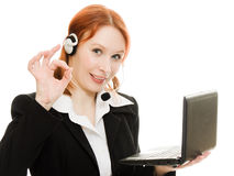 Woman operator helpline with laptop computer Stock Images