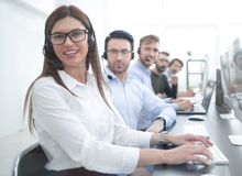 Woman operator in the workplace at the call center stock image