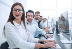 Woman operator in the workplace at the call center stock images