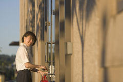 Woman Opnening Door With Key - Vertictal Royalty Free Stock Photo