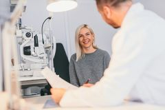 Woman in optician`s office, having an appointment. Diagnosis, medical advise and treatment royalty free stock photos