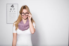 Woman at optician's office. Young beautiful woman with glasses at optician's office royalty free stock photography
