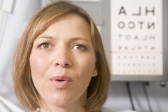 Woman in optometrist's exam room Stock Photos