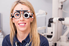 Woman in optometrists office correcting her vision Royalty Free Stock Photography