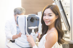 Woman with optometry. Woman smile with optometry in the optical shop Royalty Free Stock Photo