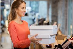 Free Woman Or Shop Assistant With Shoe Boxes At Store Stock Photos - 105975753