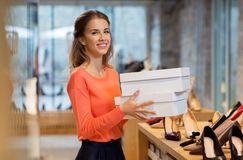Free Woman Or Shop Assistant With Shoe Boxes At Store Stock Images - 106280154