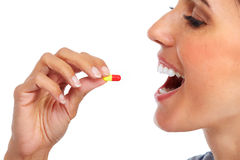 Woman with oral pill. Stock Images
