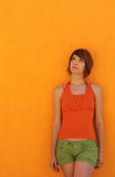 Woman in orange Stock Image