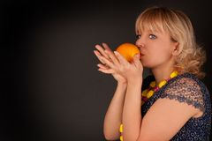 Woman with orange Stock Photography