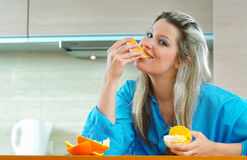 Woman with orange. Young blond woman with orange Royalty Free Stock Photos