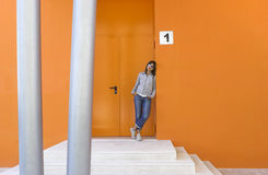 Woman in orange Stock Images