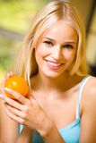 Woman with orange Royalty Free Stock Photos