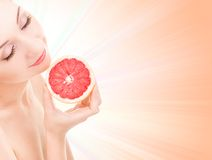 Woman with orange Royalty Free Stock Photo
