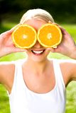 Woman with an orange Stock Photos