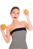 Woman with orange Stock Images