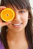 Woman with an orange Stock Photography