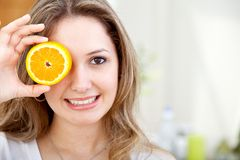 Woman with an orange Stock Image