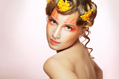Woman with orange artistic visage Royalty Free Stock Image