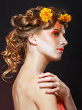 Woman with orange artistic visage Royalty Free Stock Photos