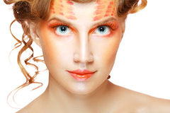 Woman with orange artistic visage Stock Image