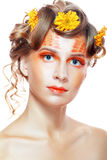 Woman with orange artistic visage Royalty Free Stock Photo