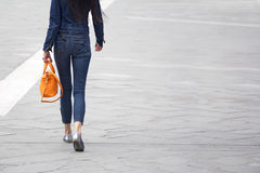Woman with orange bag Royalty Free Stock Image
