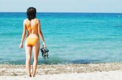 Woman in orange bikini on the beach Royalty Free Stock Photography