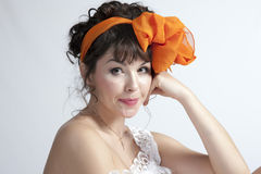 Woman with orange bow Stock Images