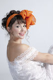 Woman with orange bow Stock Photos