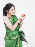 Woman with an orange chic Stock Photos