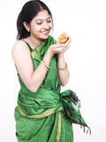 Woman with an orange chick Stock Photos