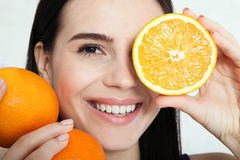 Woman with orange close-up face. Beautiful women exists to clean skin on the face. Asian woman. stock image