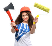 Woman in orange construction safety hat show axe paint brush Stock Image