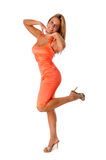 Woman in Orange Dress Stock Photos