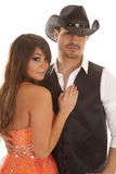 Woman orange dress hand on cowboy Royalty Free Stock Photography