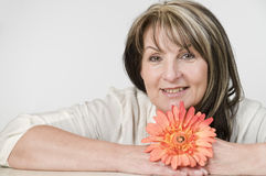 Woman and orange flower Royalty Free Stock Photo