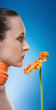 Woman with the orange flower. Royalty Free Stock Photo