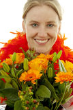 Woman with orange flowers Stock Photos