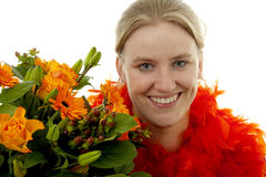 Woman with orange flowers Royalty Free Stock Image